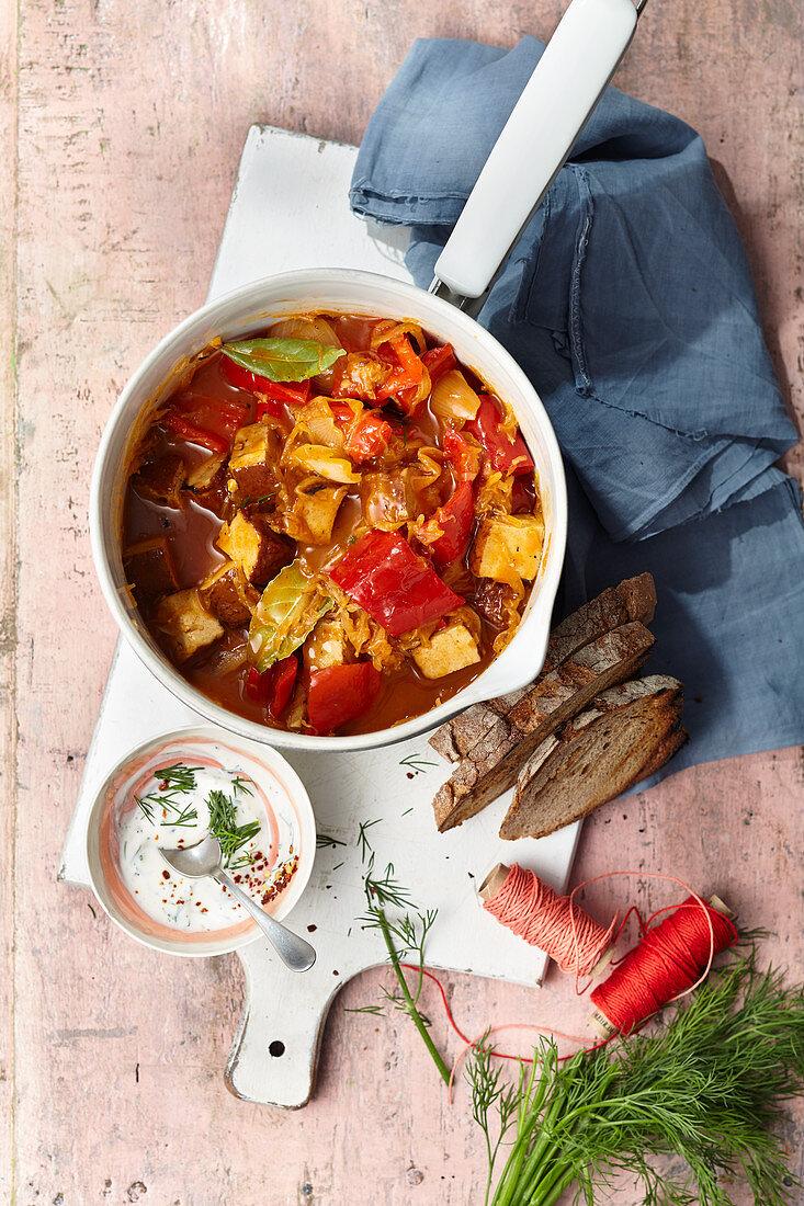 Szegediner tofu goulash with dill soy yoghurt for vegans