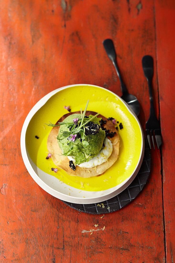 Cucumber sorbet with lemon sour cream and vegetarian caviar substitute