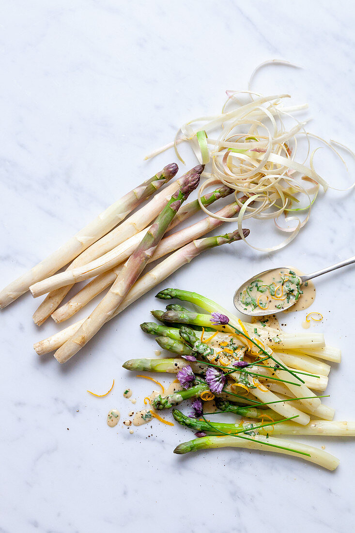 White and green asparagus with herb sauce
