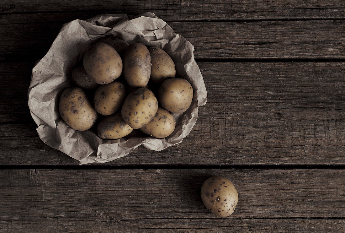 Organic potatoes on a wooden table