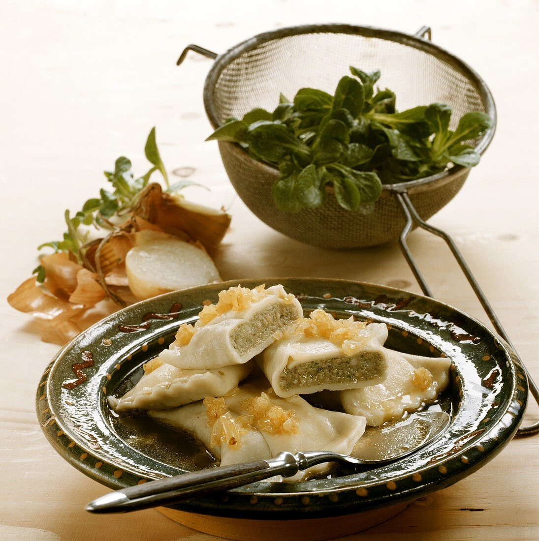 Classic Maultaschen (pasta envelopes) in broth; corn salad