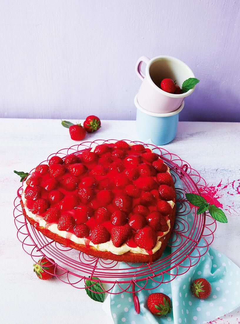A heart-shaped strawberry sponge cake