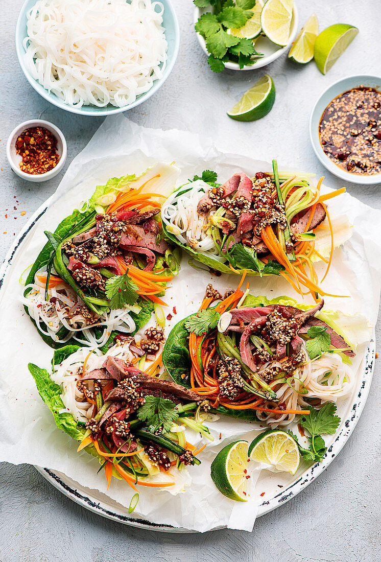 Korean-inspired lettuce wraps with beef and sesame seeds