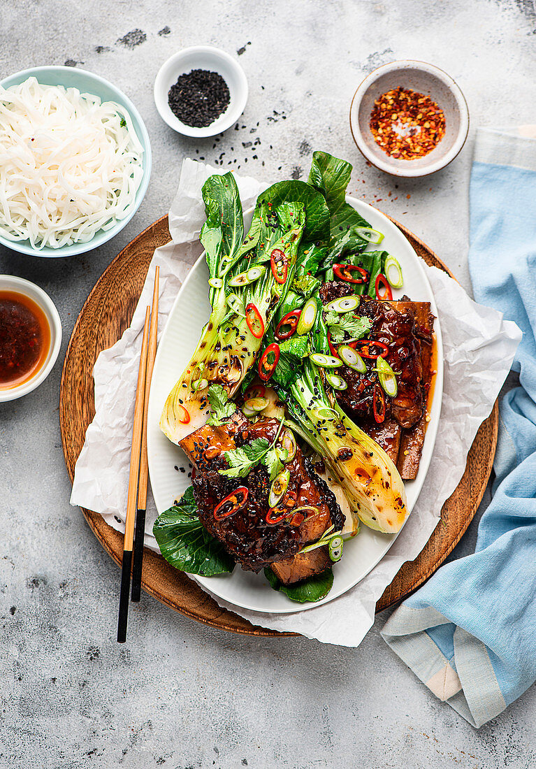 Korean-style beef ribs with bok choy and rice noodles