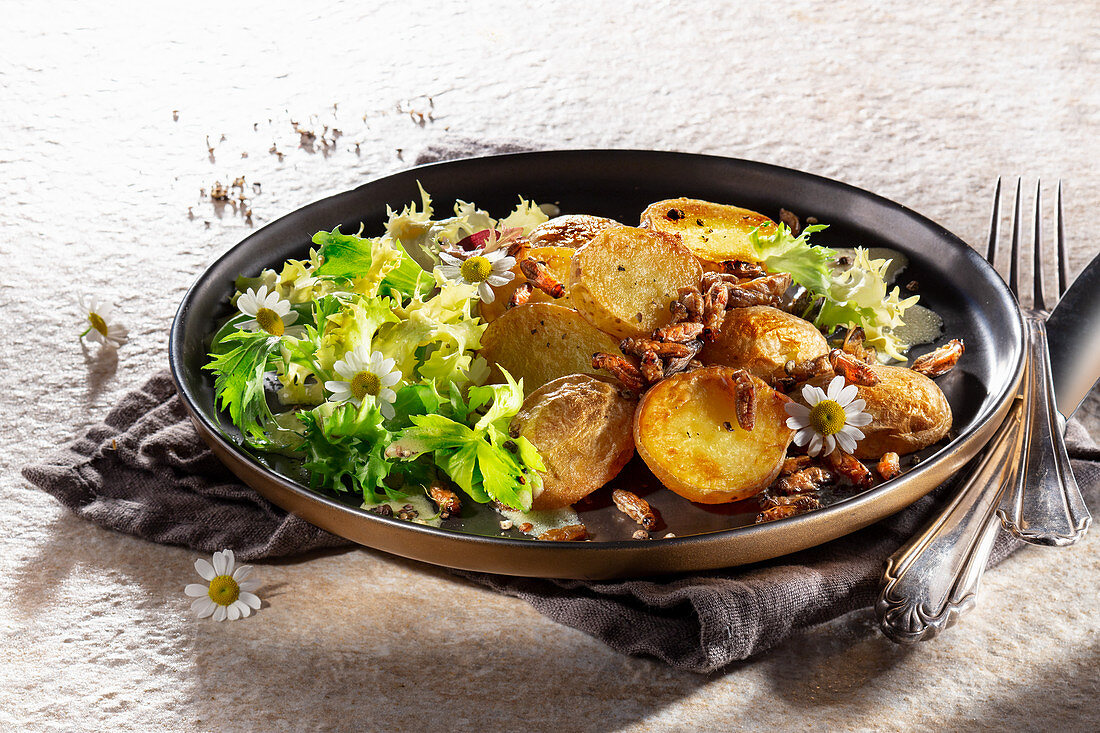 Roasted potatoes with salad
