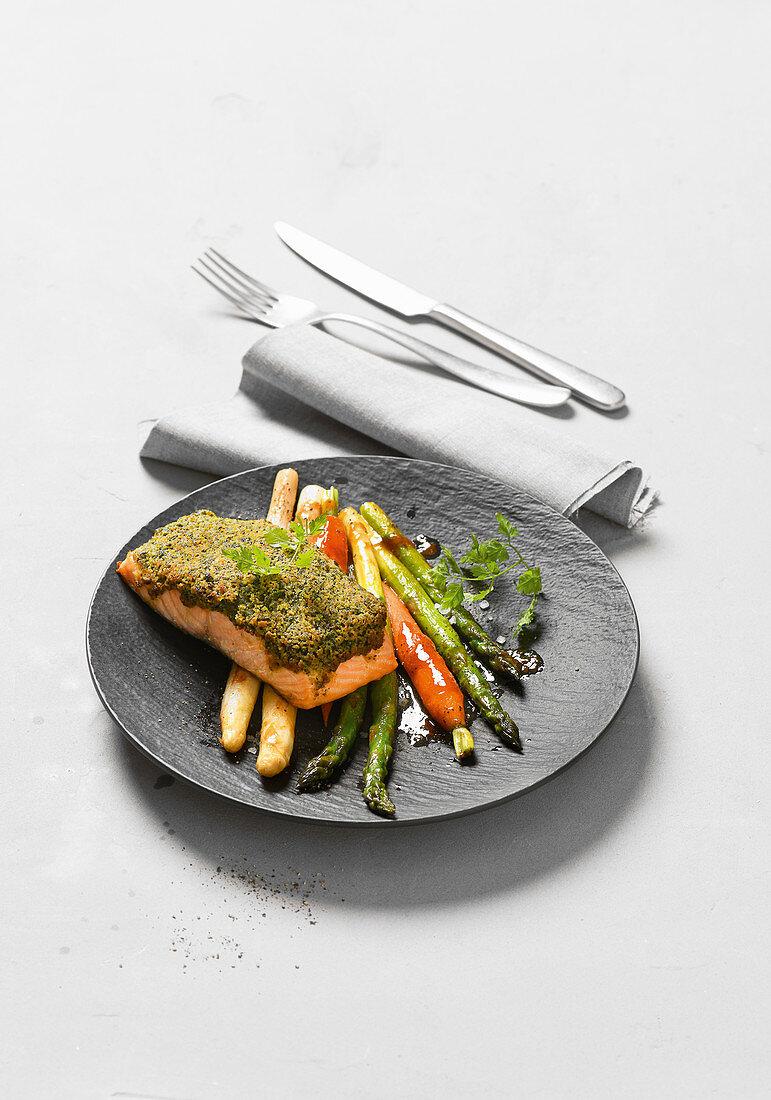 Herb salmon au gratin on colored asparagus