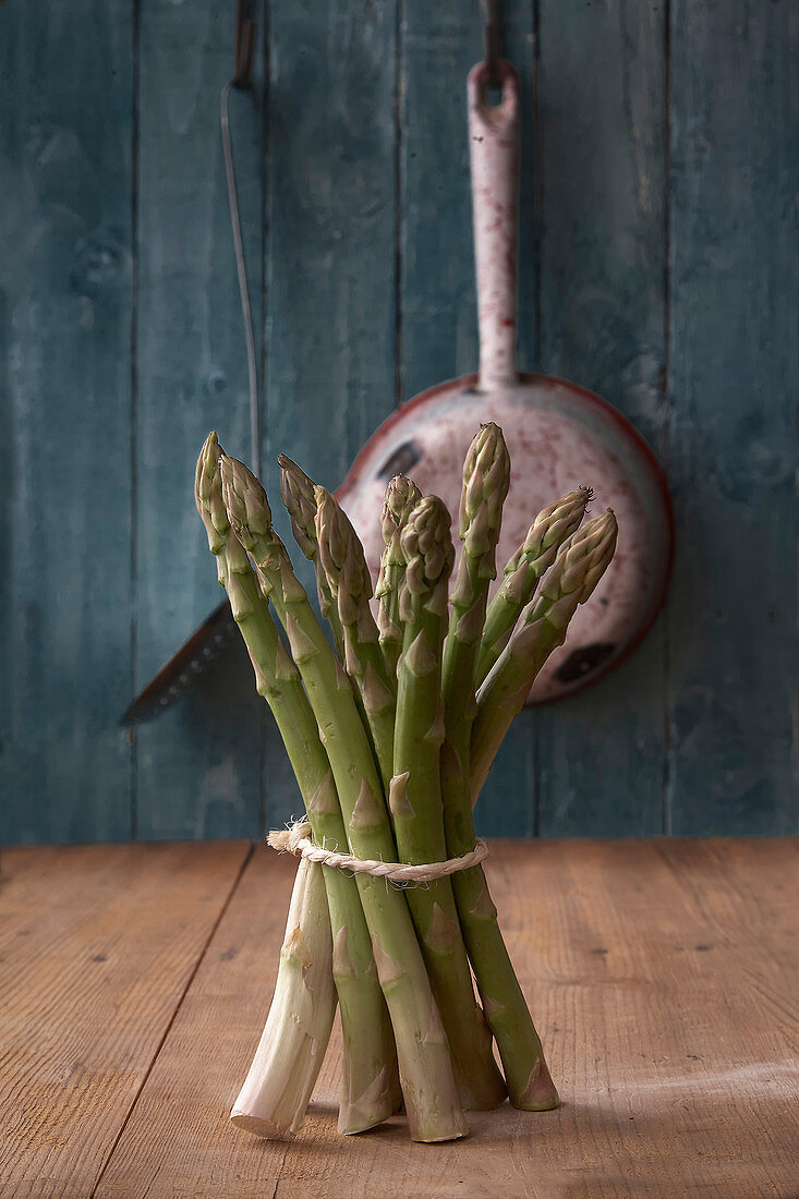 Bundle of asparagus in a country kitchen
