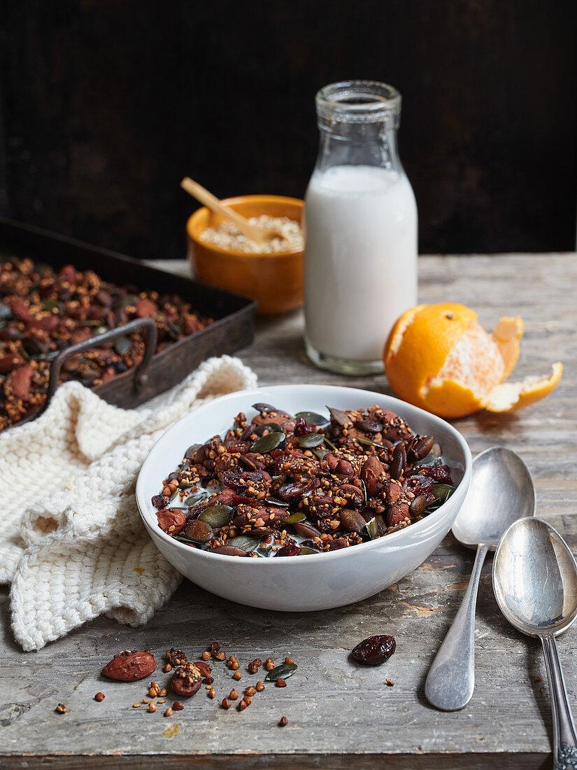 Crispy buckwheat granola with seeds and almond milk
