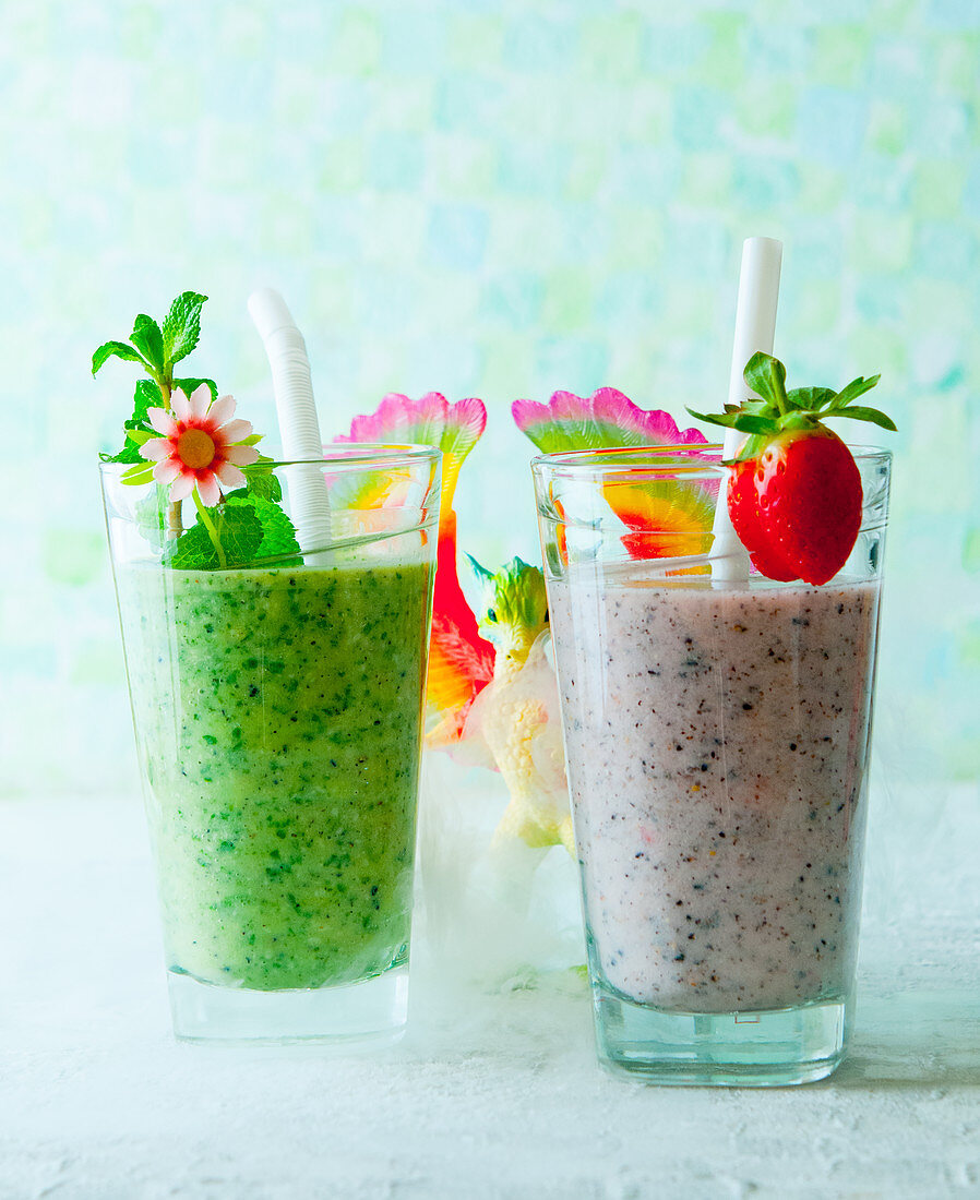 A mint and spinach smoothie and a strawberry smoothie in the land of dragons