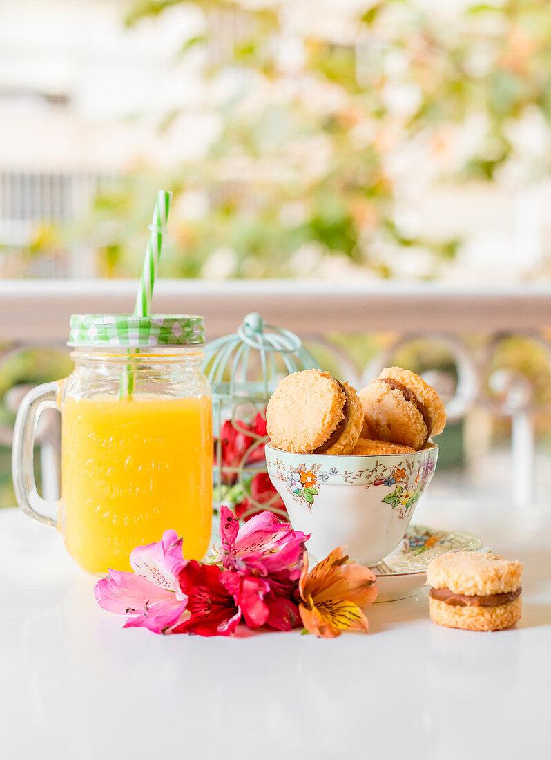 Nut alfajores and orange juice