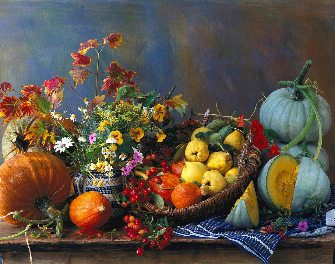Autumn still life with pumpkins and quinces