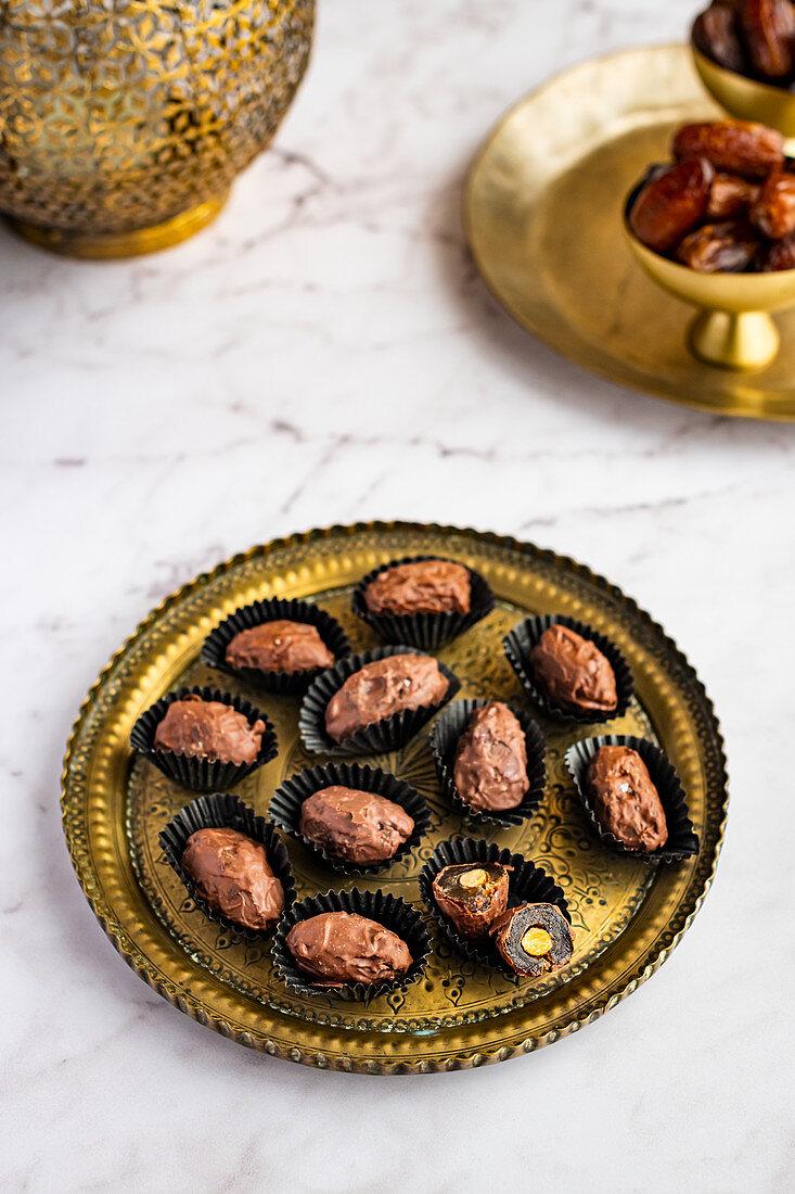 Almond stuffed dates coated with dark chocolate