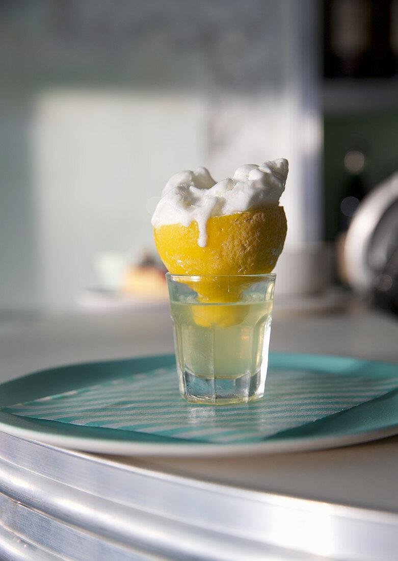 Lemon sorbet served in an iced lemon half