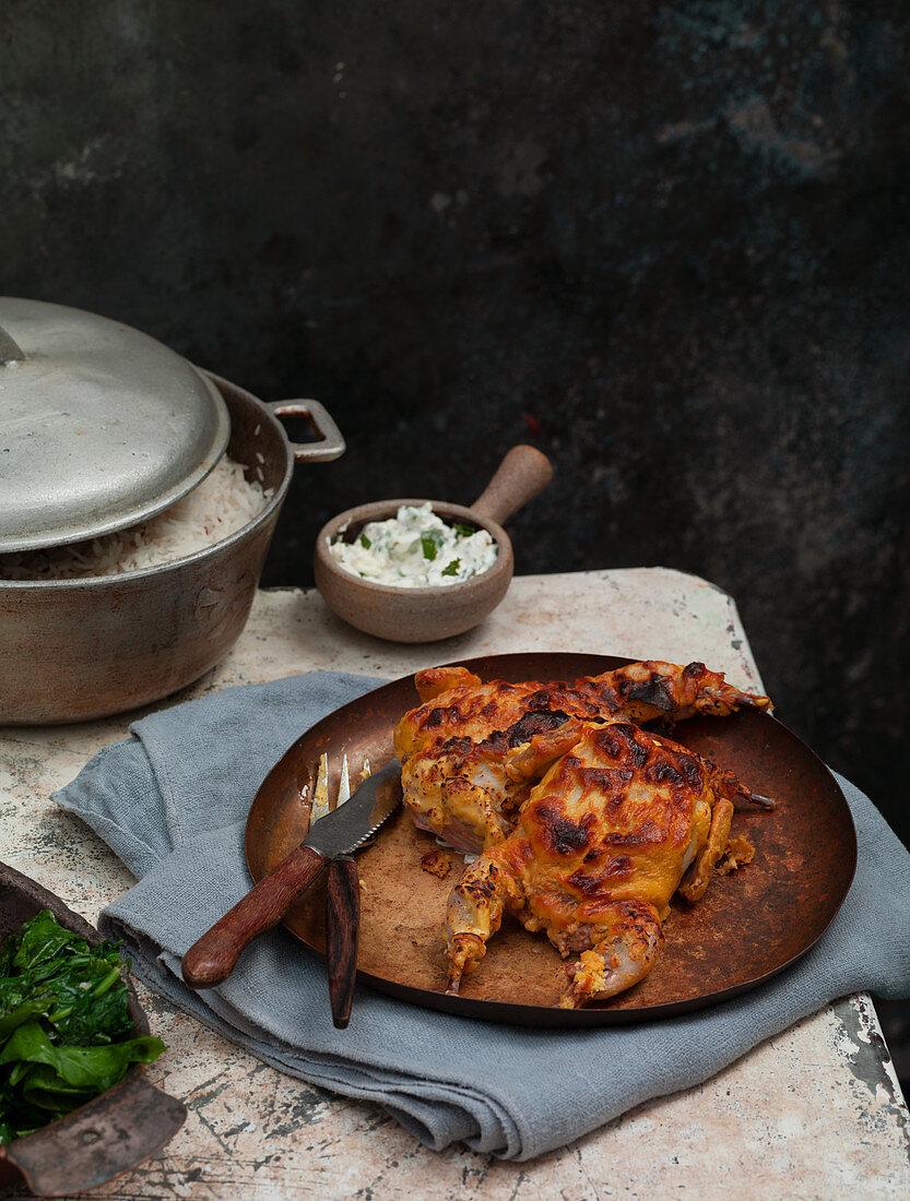 Fried Asian seasoned quail on an outdoor table