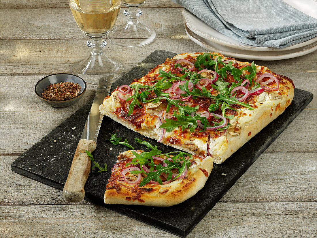 White pizza with mushrooms, sour cream and rocket
