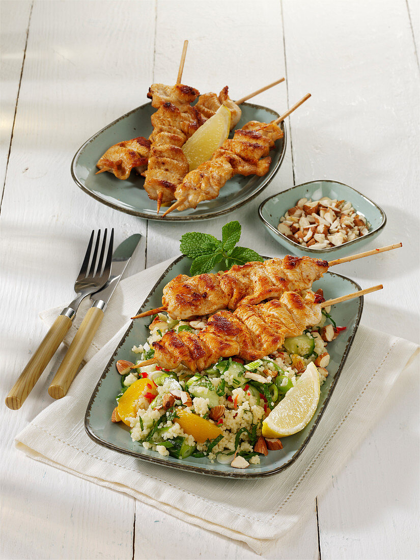 Chicken skewers on couscous