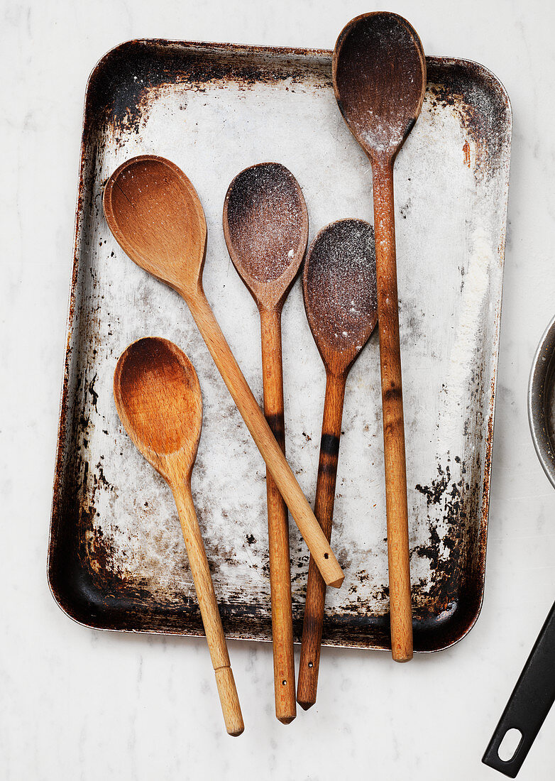 Wooden spoons on a vintage baking sheet