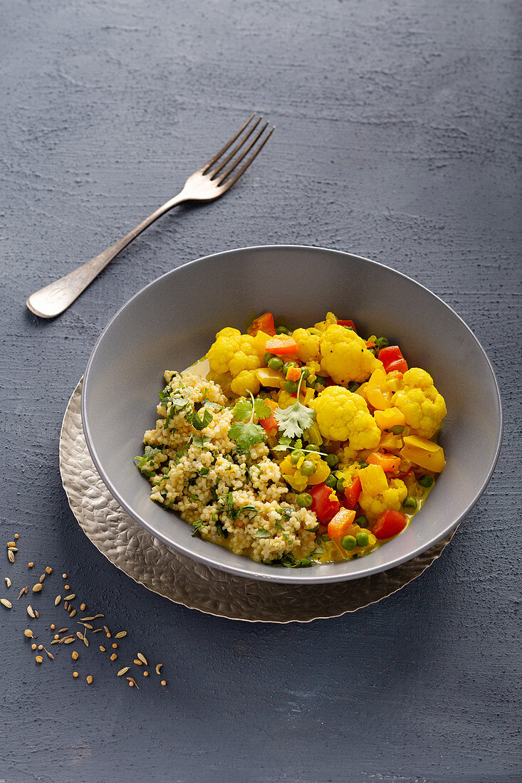 Cauliflower curry with turmeric and millet