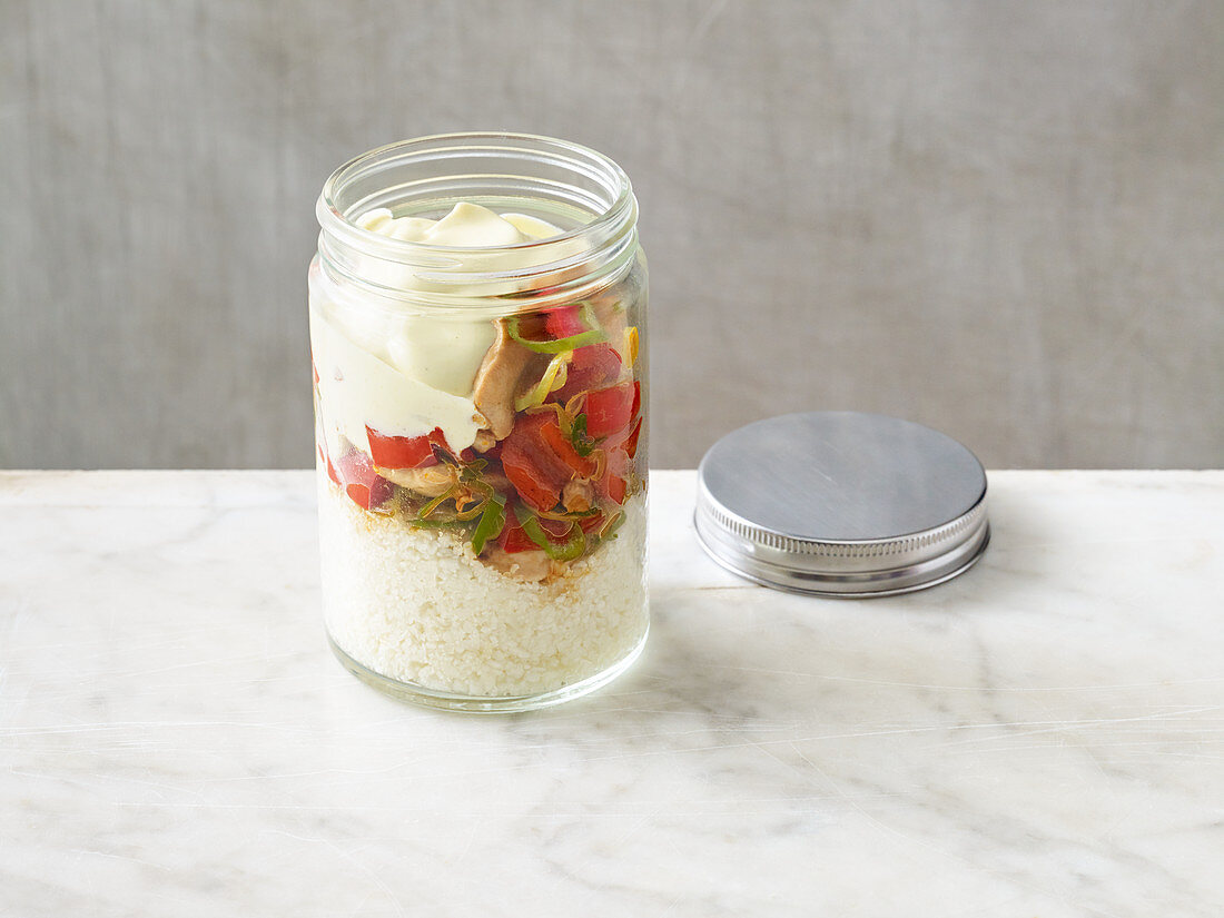 Chicken breast rice salad in a jar to go