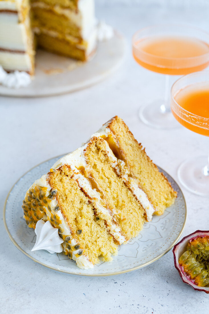 A slice of 'Pornstar Martini Cake' with passion fruit and meringue