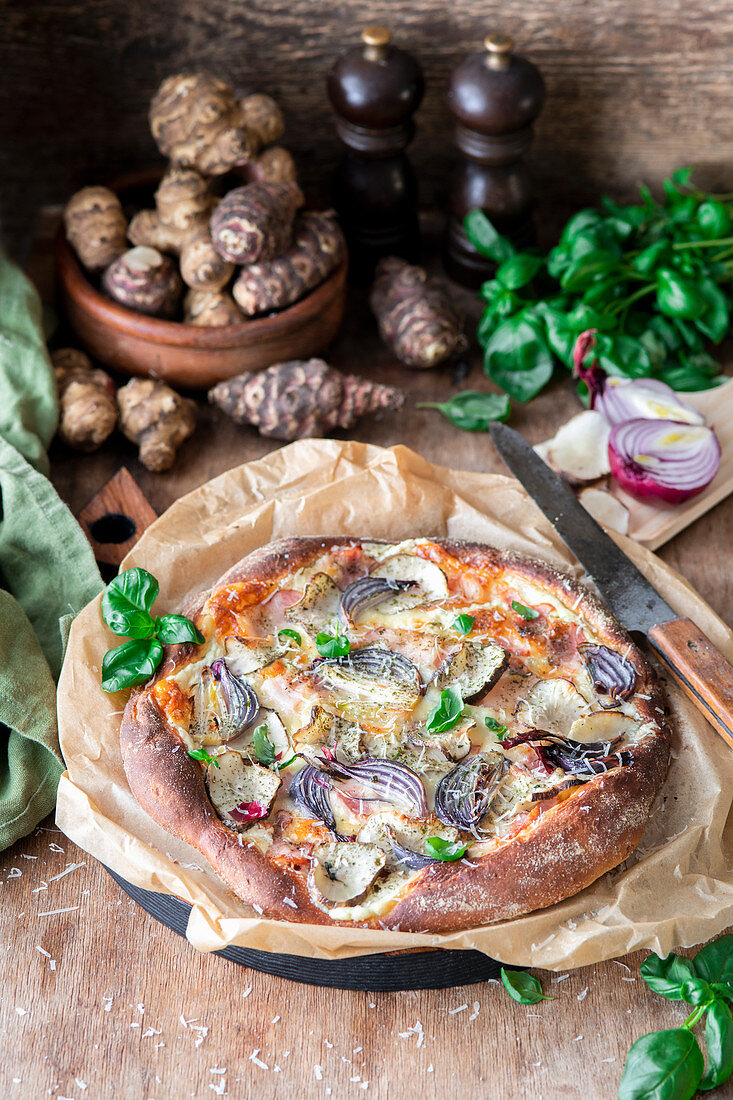 Jerusalem artichoke pizza bianca with bacon and onion