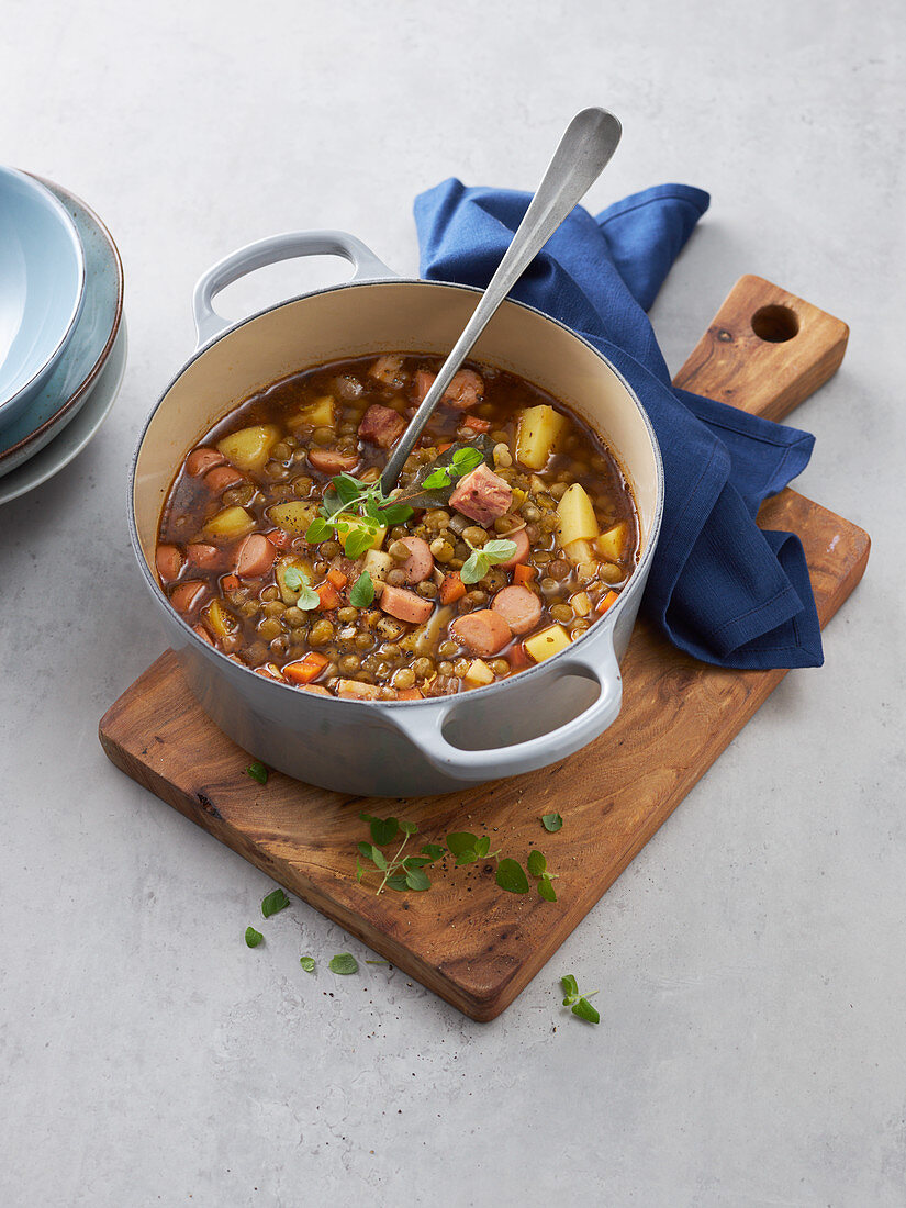 Grandma's pea stew with bacon, sausages and potatoes