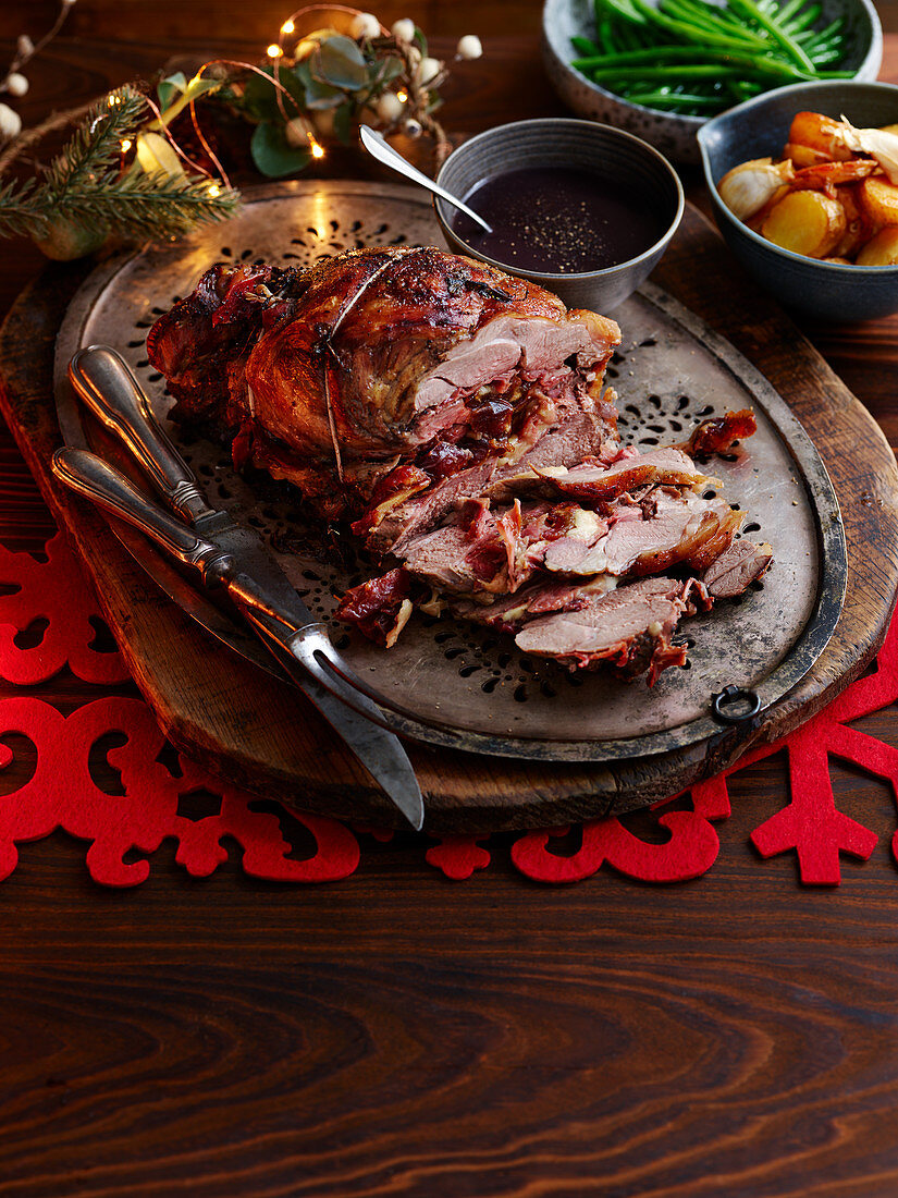 Leg of lamb stuffed with ham, cheese and dates