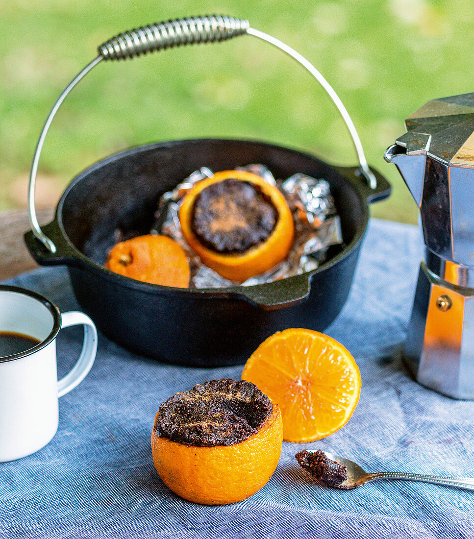 Campfire orange cakes baked in a Dutch oven