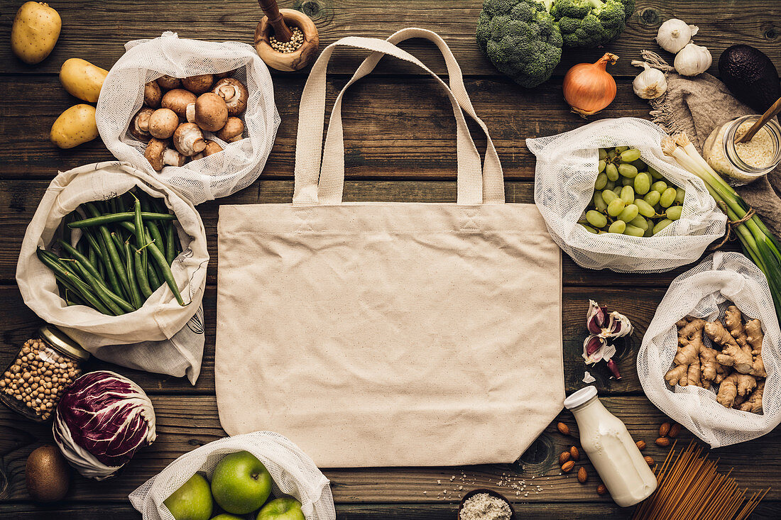 Zero waste concept, eco bags and glass jars with food