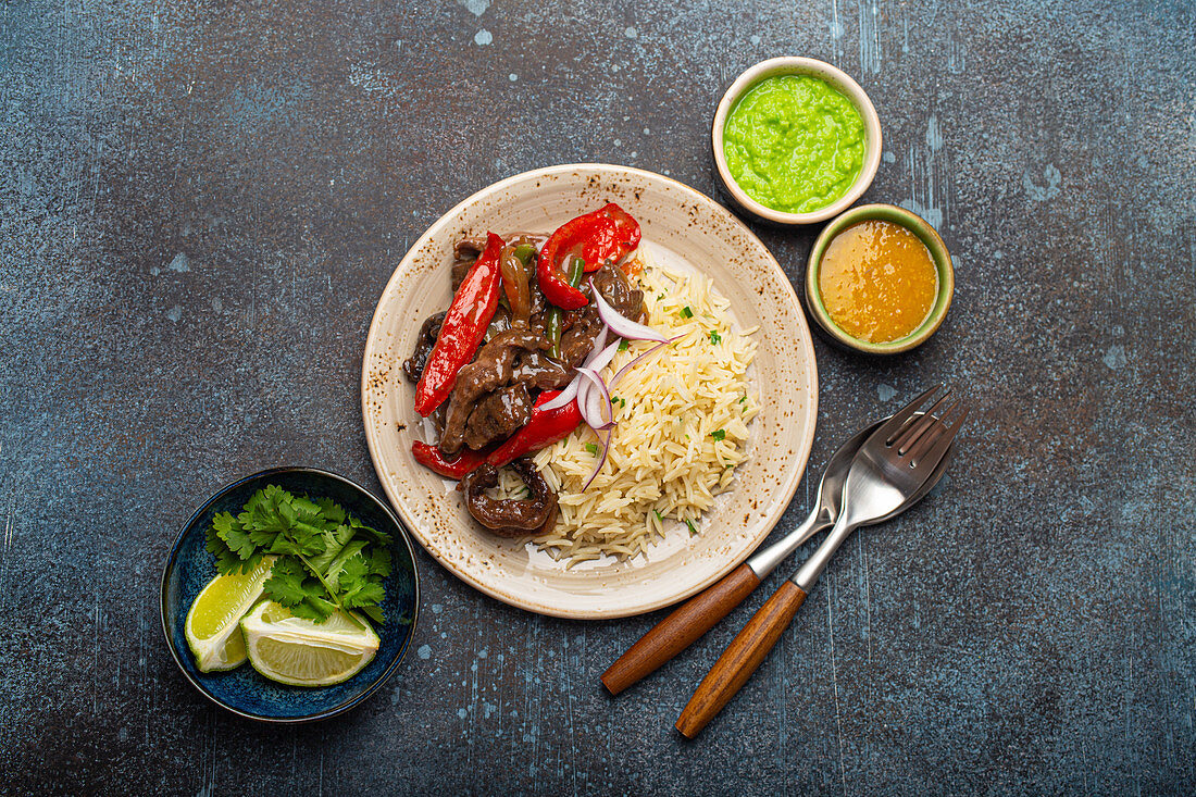Lomo saltado, beef tenderloin with peppers (traditional dish of Peru)