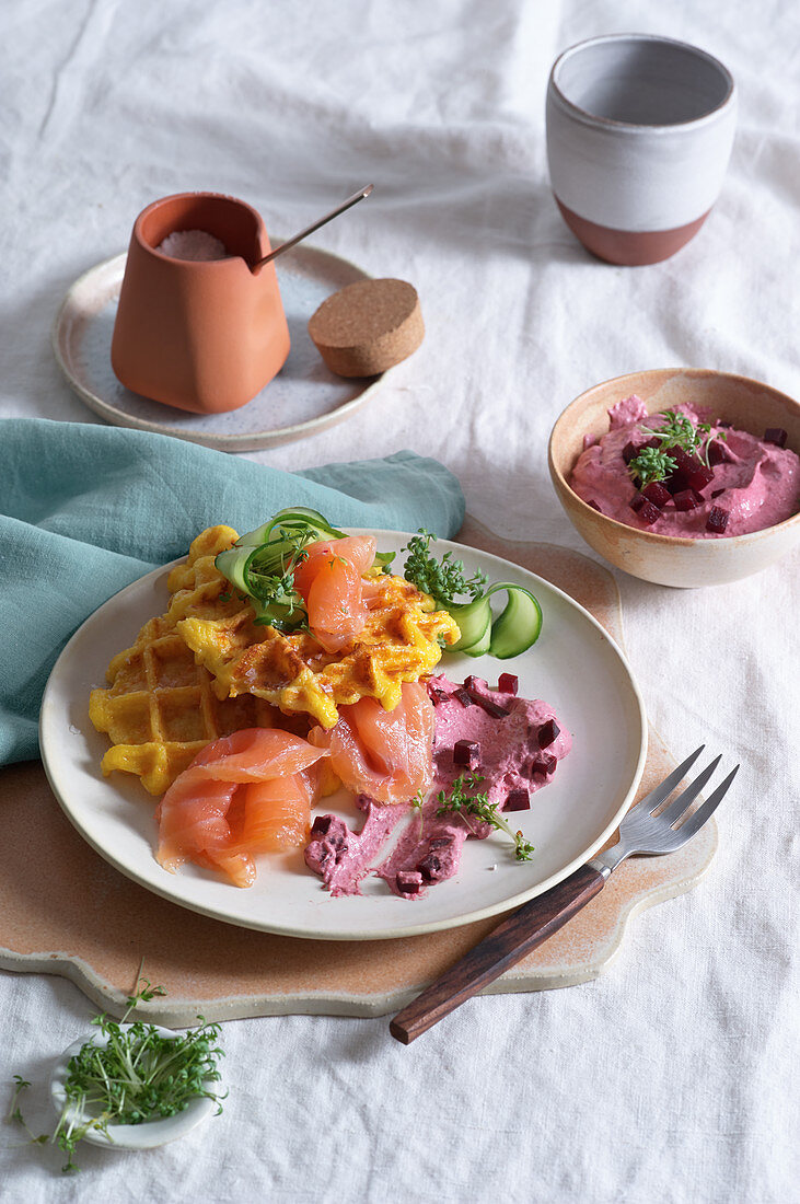 Sweet potato waffle with salmon and beetroot cream