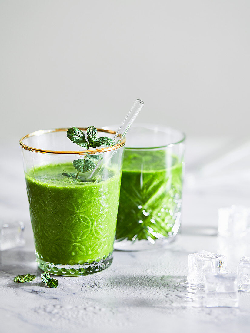 Green spinach and herb smoothies