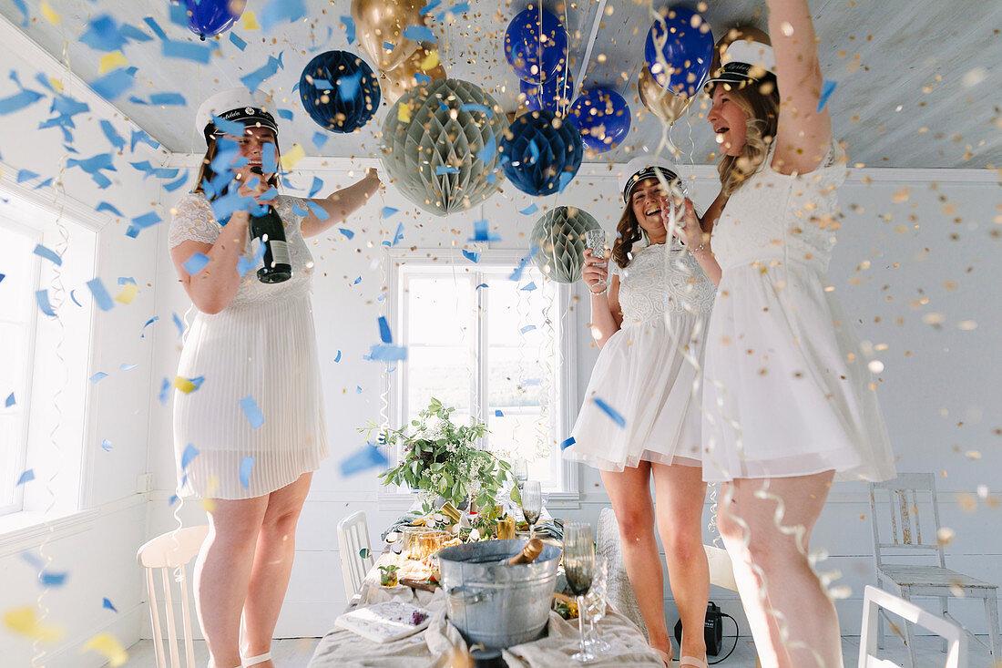 Women celebrating graduation