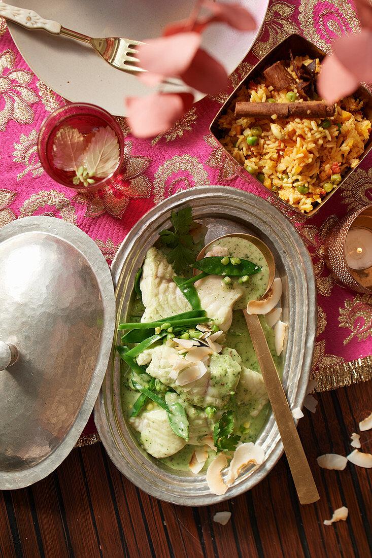 Indian green fish curry with biryani rice