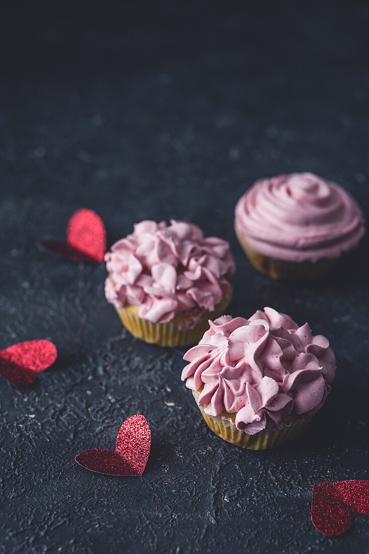 Valentine's Day cupcakes on a dark surface