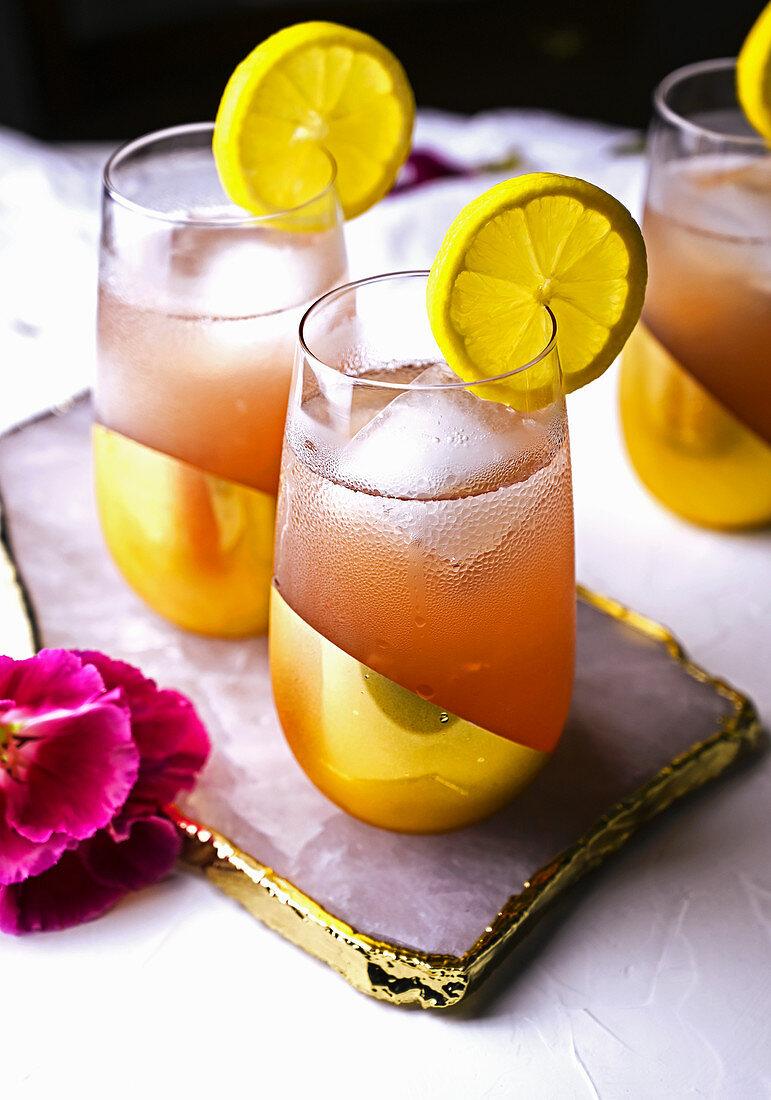 Pink Bikini tropical cocktail in gold glasses