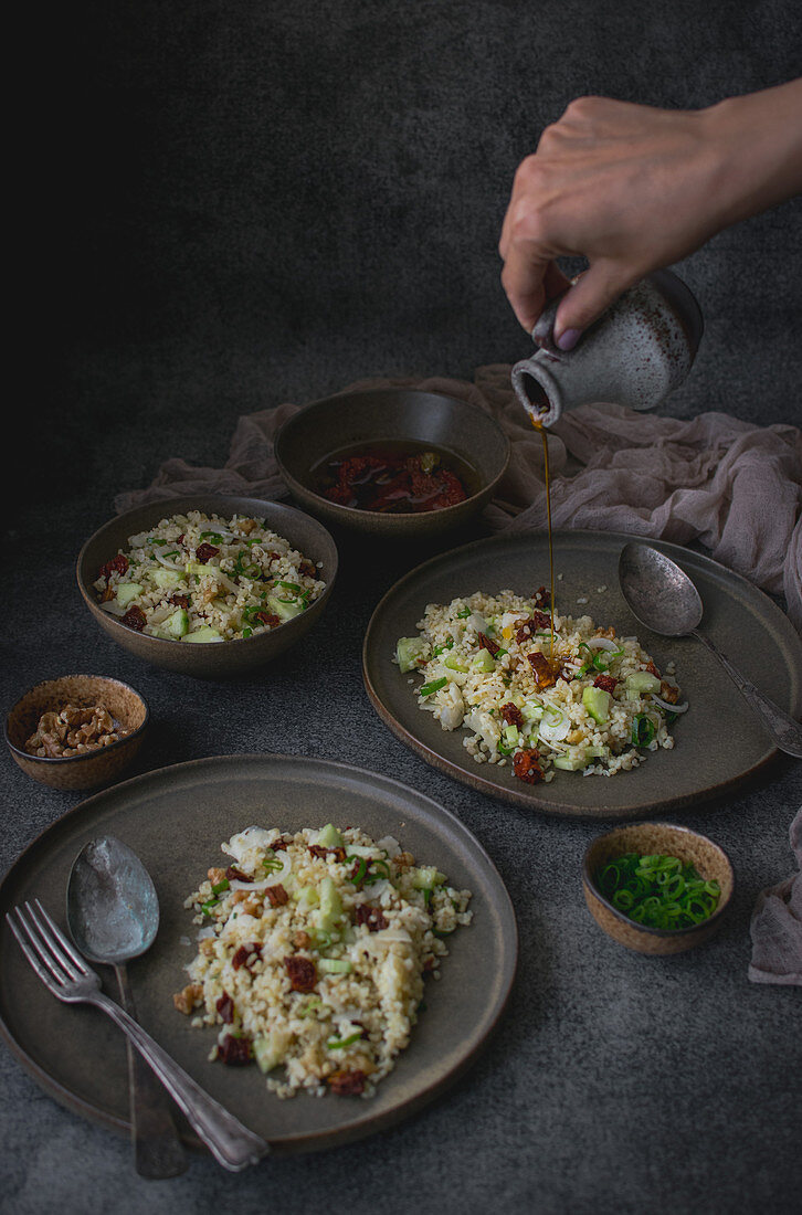 Bulgur salad with dried tomatoes, cucumber and parmesan cheese