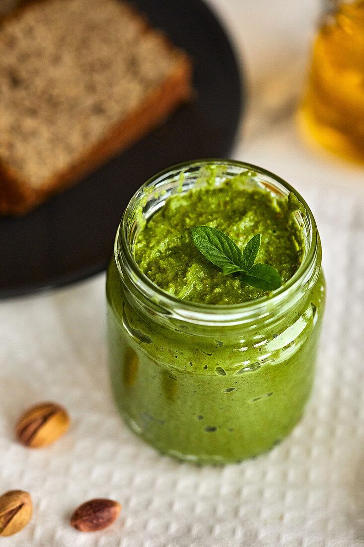 Homemade basil and arugula pesto in a jar