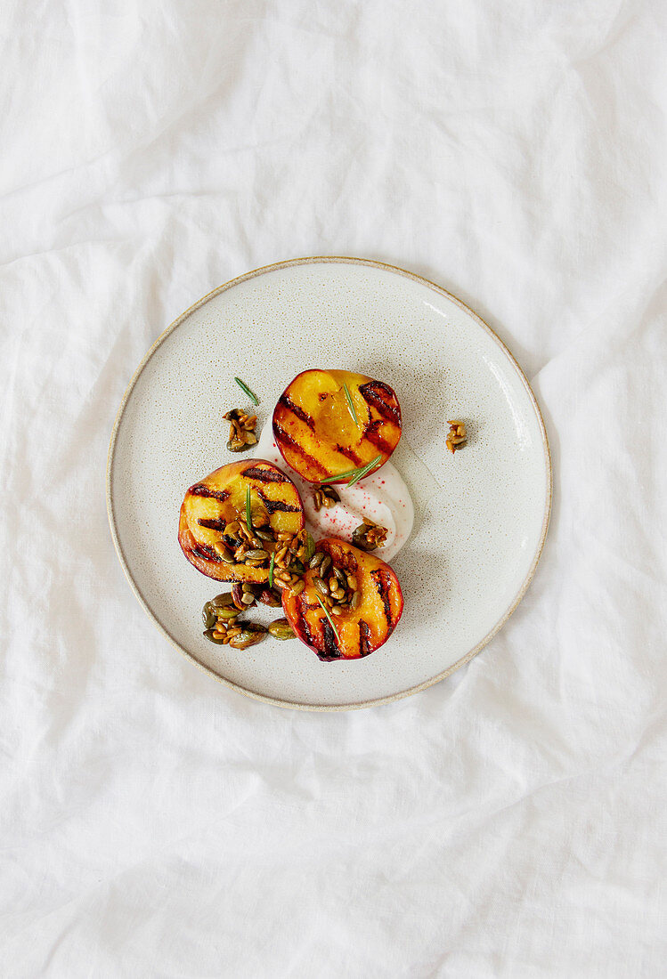 Grilled peaches with caramelized nuts