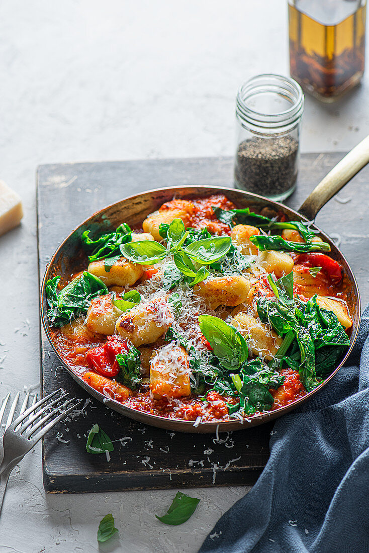 Potato gnocchi with tomato sauce, spinach, basil and parmesan cheese