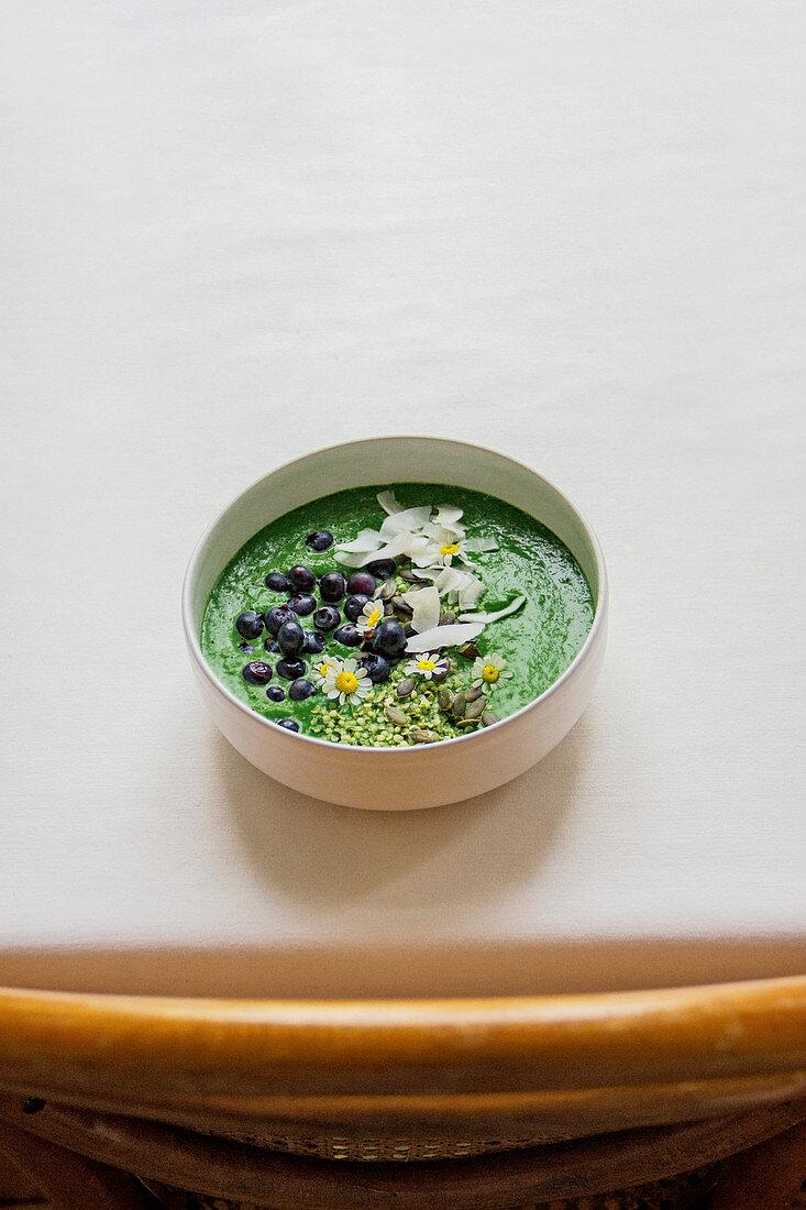 Deep green spirulina bowl with hemp seeds and coconut water