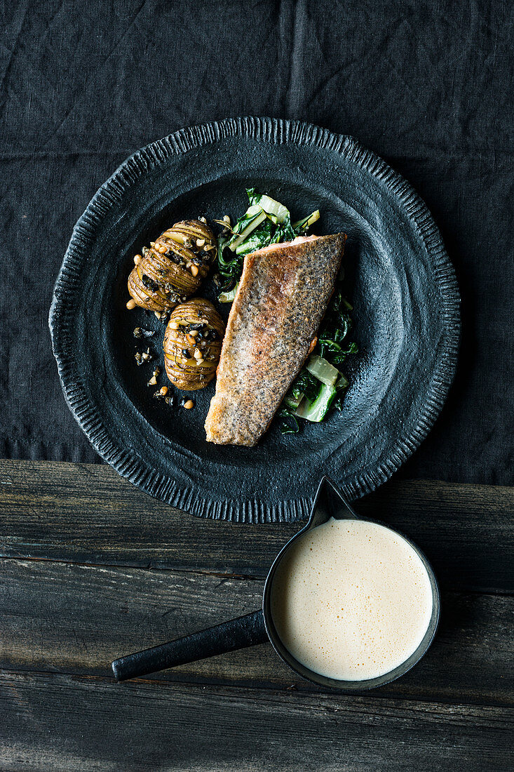 Salmon trout with chard and hasselback potatoes