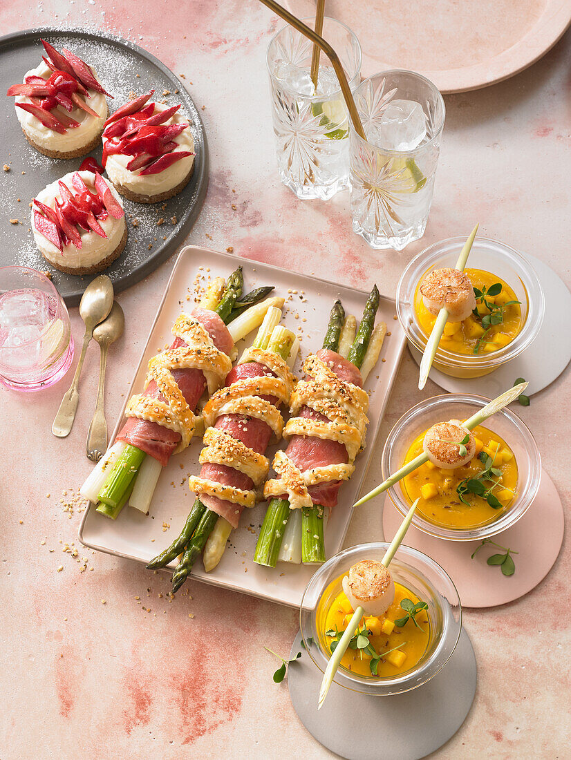 Baked asparagus parcels, mini cheesecakes, and mango-and-carrot soup