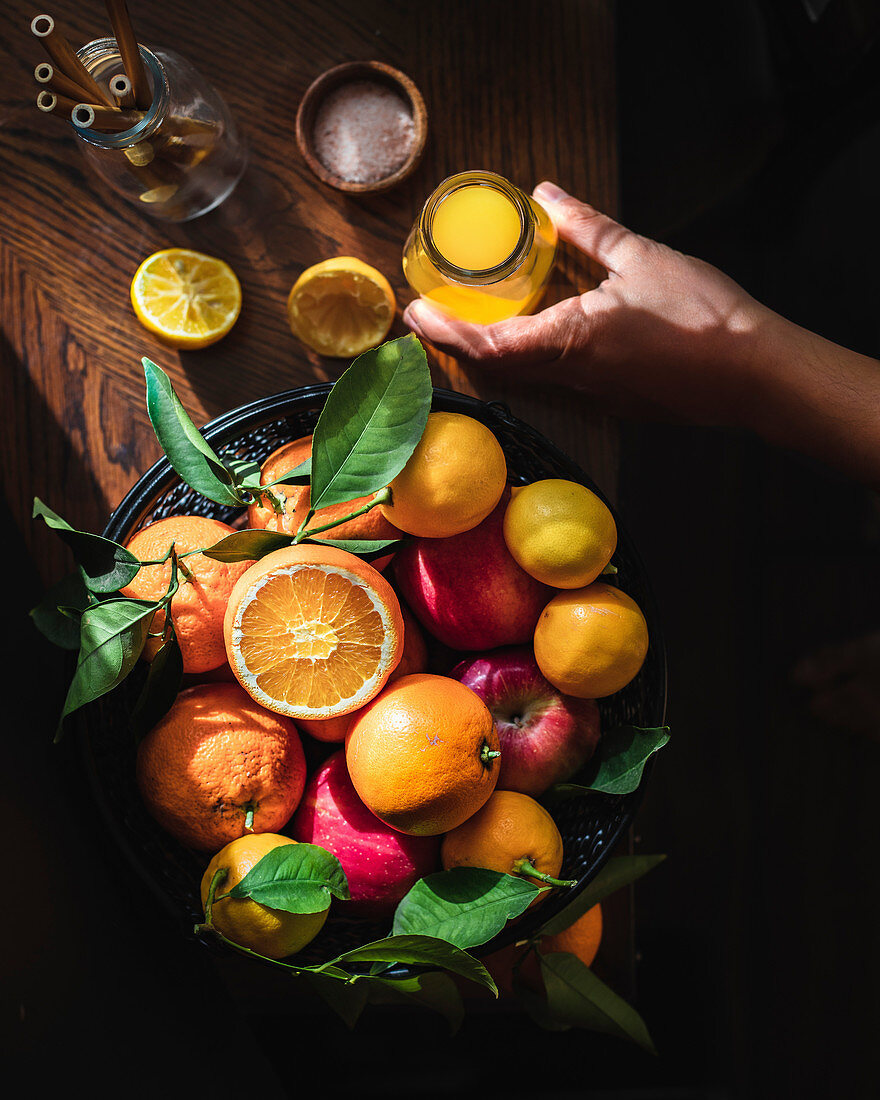Citrus fruit in a basket and fresh juice