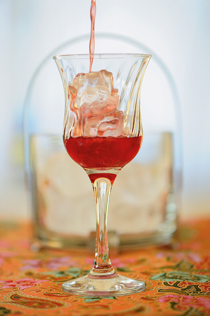 A Rosella drink with lemongrass, ginger and rum