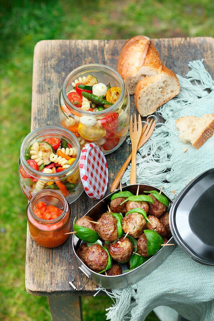 Polpette with tomato dip and antipasti pasta salad