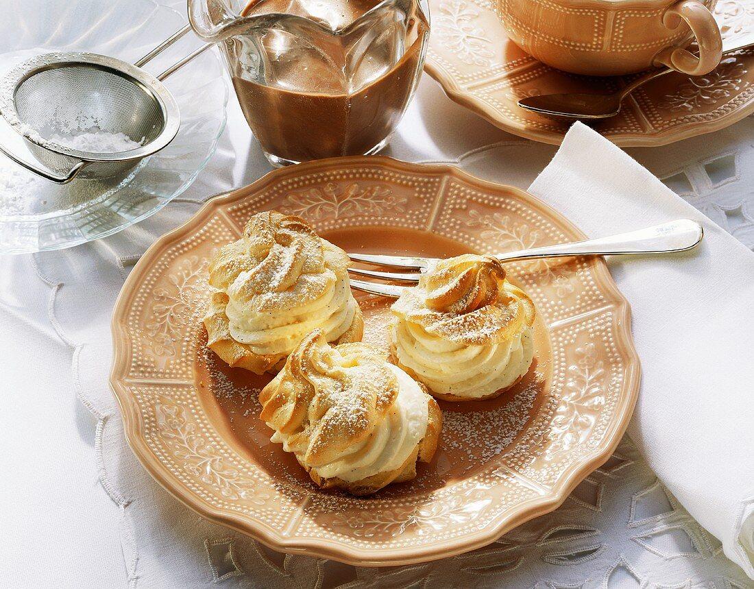 Three profiteroles with vanilla cream