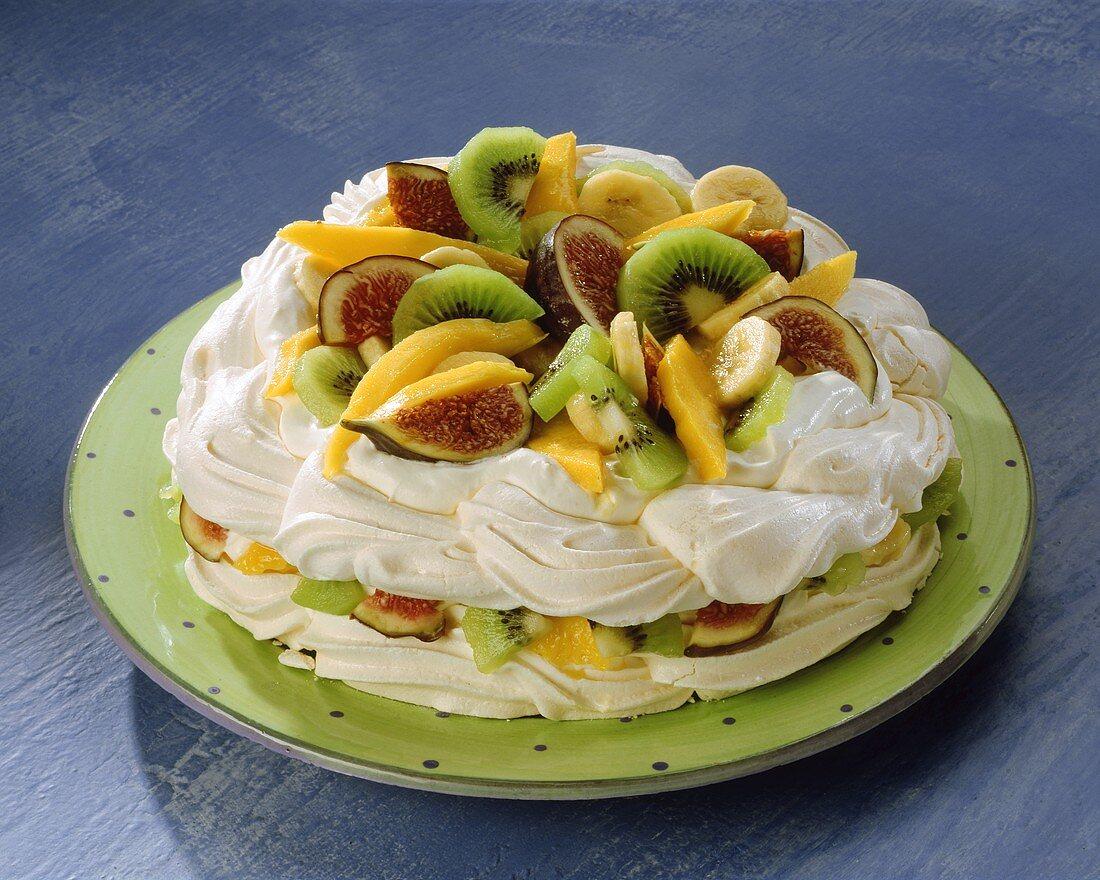 Meringue gateau with exotic fruit