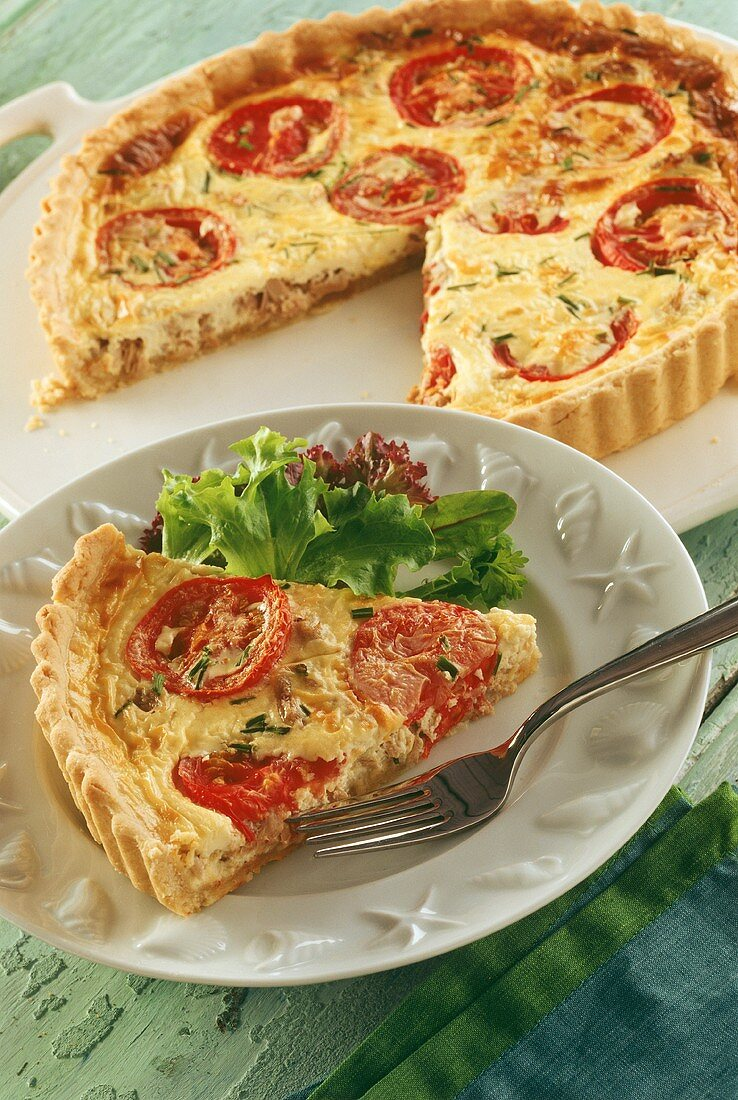 Tomato quiche, one piece on plate with lettuce