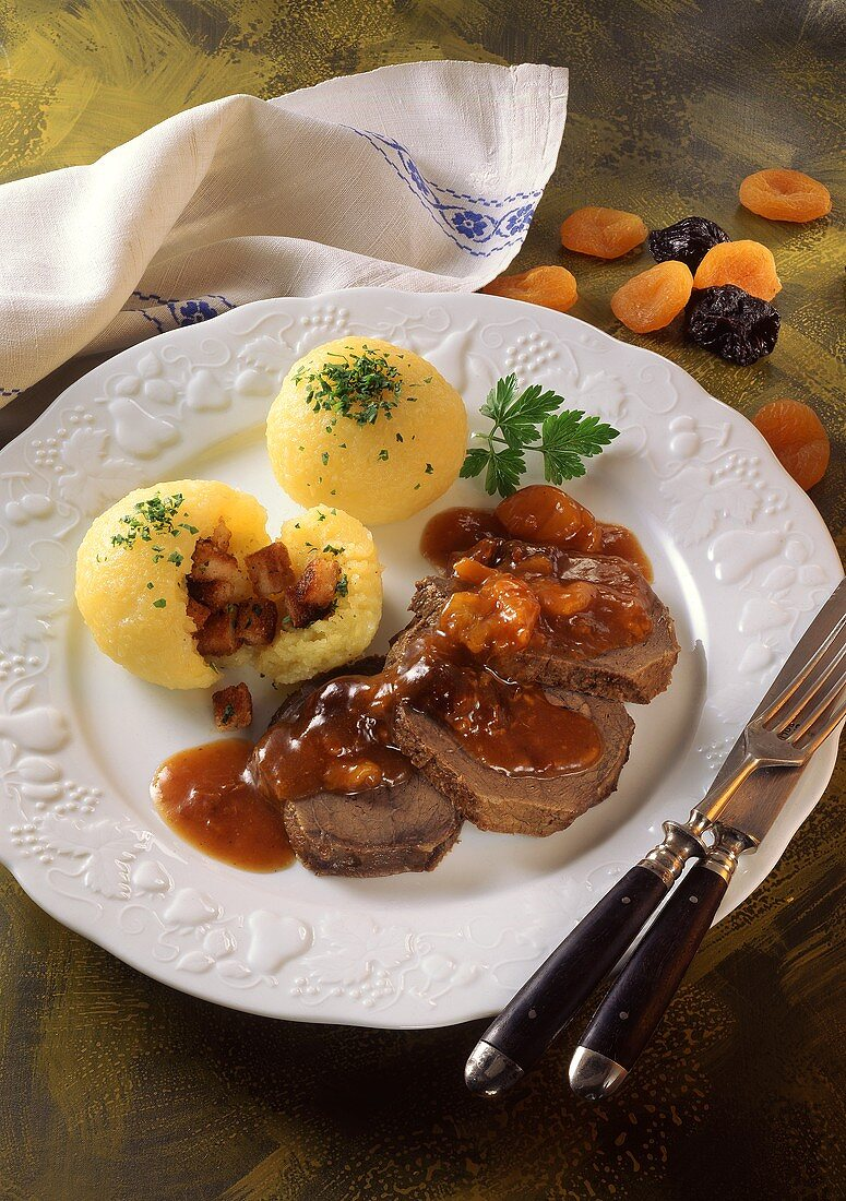 Braised pickled beef with dried fruit sauce & potato dumplings